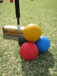 Croquet mallet and primary coloured balls