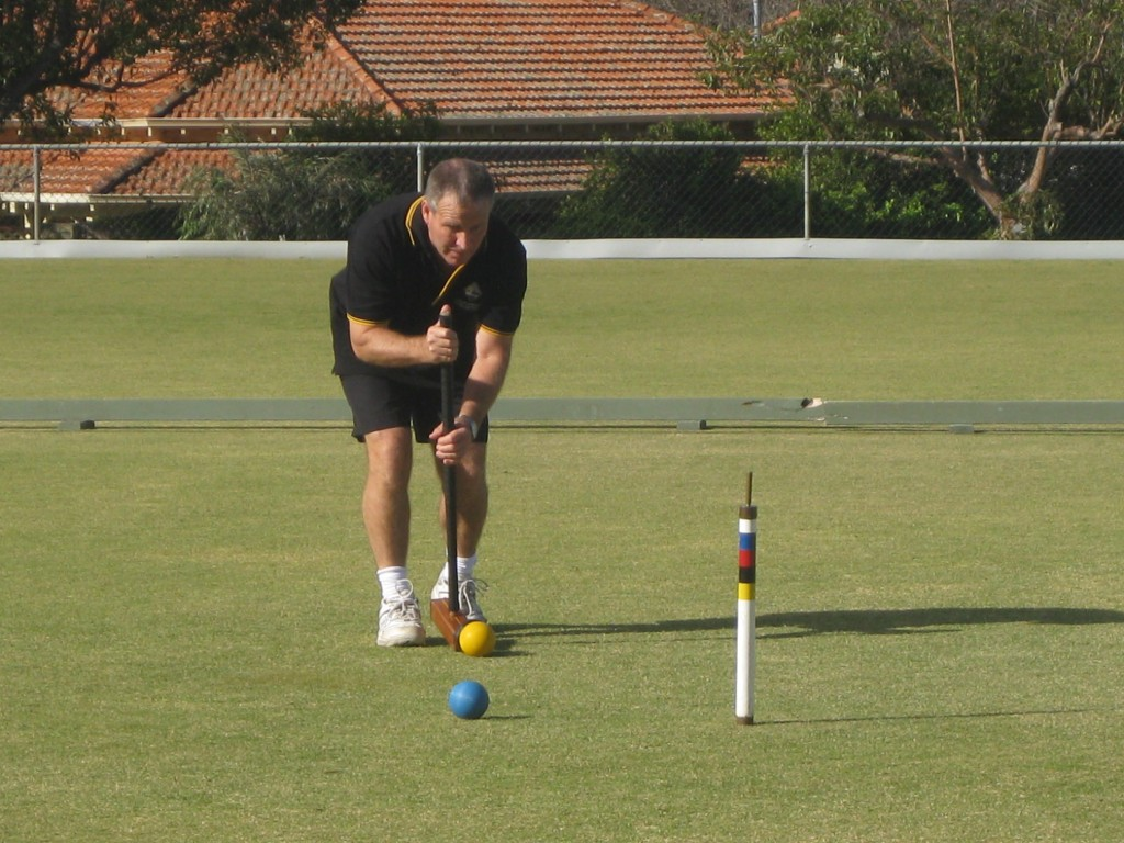Winner Alan Sands of Como Croquet Club in action during the final game