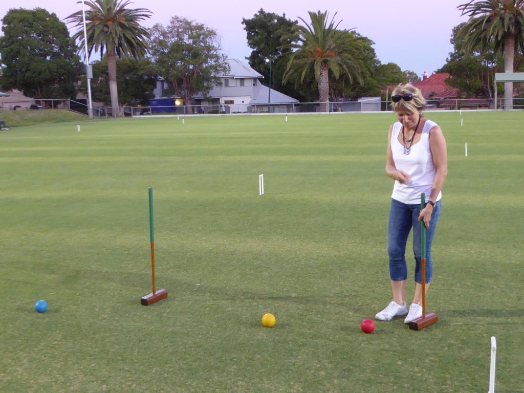 Sabene, visitor from Germany, playing croquet for the first time!