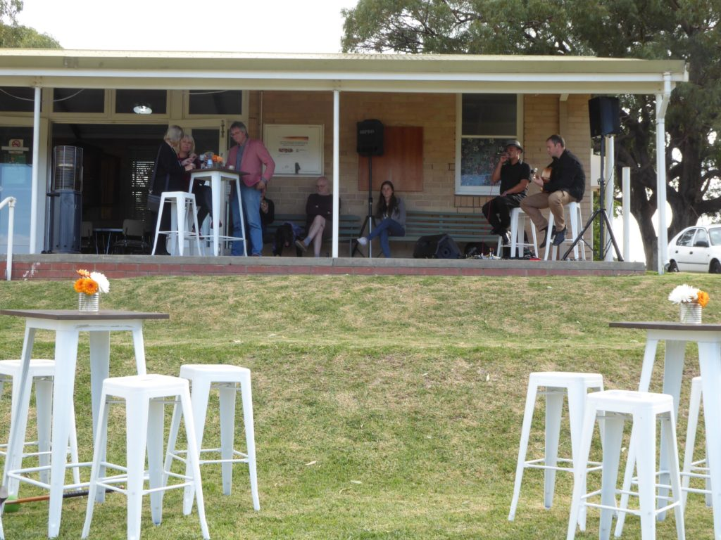Live music on the veranda overlooking the lawns